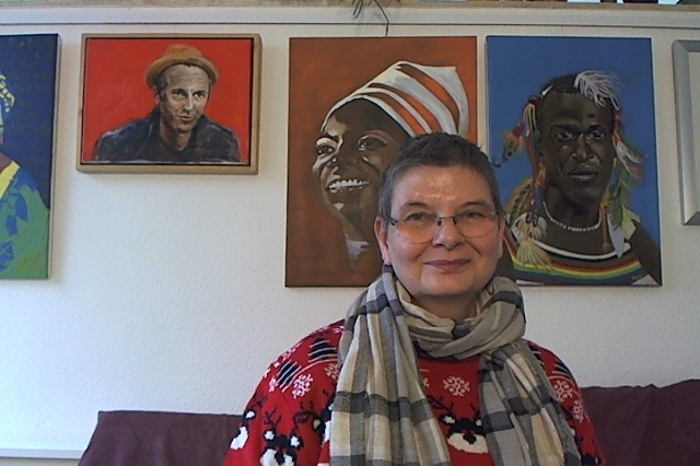 Karin Merx in front of her portraits, oil on canvas, thinking happy thoughts. That is also the power of words